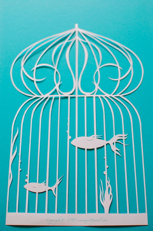 Sinemage Papercut fish in bird cage
